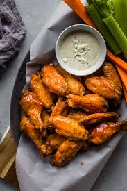 platter of air fryer en wings with buffalo sauce and blue cheese