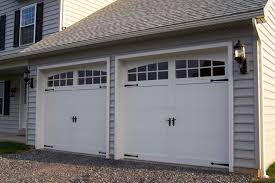 two car garage doorWhite Door In Two Car Garage Has Black Handle And Wall Lamp  footcap