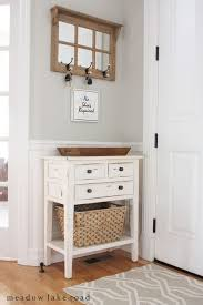 small entry table with mirror and key hooks above wwwmeadowlakeroadcom cheap entryway furniture