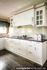 french provincial kitchen tiles. kitchen of white and neutral colouring, with slate tiles, wooden accents, stainless steel french provincial tiles