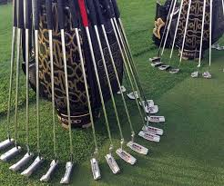 our scotty cameron staff bag on the practice green at bay hill