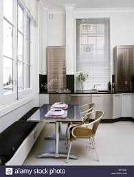 floor seating dining table. Modern, Eat-in Kitchen With Stainless Steel Cabinets, Dining Table Banquette Seating, Tile Floor, And Tall Windows. Floor Seating R