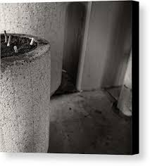 art canvas print featuring the photograph ashtray 1 noho parking structure by yopedro