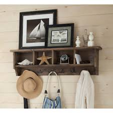 metal and reclaimed wood entryway coat hook with storage cubbies
