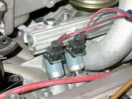 l98 engine induction system tpi vs carburetor vette magazine vemp 0607 05 z corvette l98 engine induction system