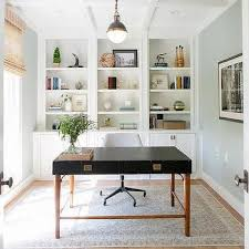 traditional home office with built in bookcases sleek black desk white rolling chair bookcases for home office