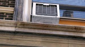 window ac why nearly a quarter of us households are stuck with ugly and loud . Window Ac Air Conditioner Support
