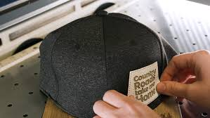 applying the adhesive leather hat patch to the front of the cap