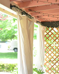 diy outdoor curtains hang after a patio makeover
