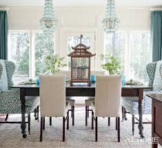 vintage dining room design with turquoise white fabric wing back dining room chair ideas blue crystal empire chandelier and decorative wooden bird cage