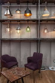 unique bulbs paired with a variety of shades together make a collection of modern lighting fixtures