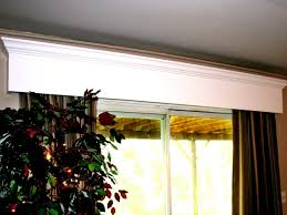 a wood window valance adds dimension to your room by topping off a window or sliding glass door