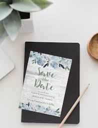 sage green dusky blue peonies on white wood save the date