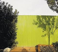 outdoors corrugated metal fence painted green