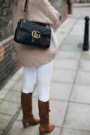 gucci marmont. white skinny jeans, tan suede knee high boots, black leather gucci marmont bag