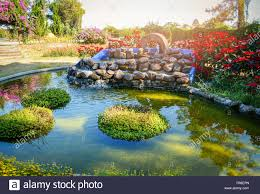 Page 2 - Koi Pond Fountain High Resolution Stock Photography and Images -  Alamy