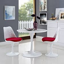 modern round white dining table