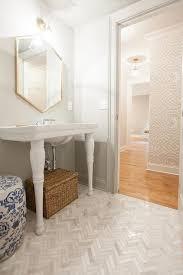 Powder Room With Marble Herringbone Floor Tiles