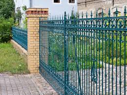 image blue cast iron garden fence with