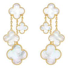 magic alhambra chandelier earclips with four mother of pearl clover shaped motifs mounted in 18k yellow gold with a beaded edge with omega style clips