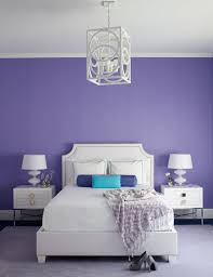 High Quality White And Purple Bedroom Features Purple Walls Lined With A White Bed With  Clipped Corner Headboard Dressed In White And Turquoise Bedding, Purple  Bolster ...