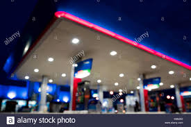 lighting blurred in gas station at night stock image