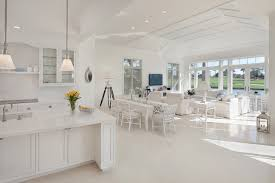 Example of an island style white floor living room design in Miami with  white walls and