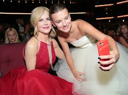millie bobby brown and emma watson. nicole kidman takes a picture with millie bobby brown from emmys 2017: celebrities\u0027 candid and emma watson