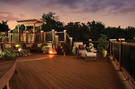 outside deck lighting. trex backyard lighting warmly illuminates a composite deck at night outside e