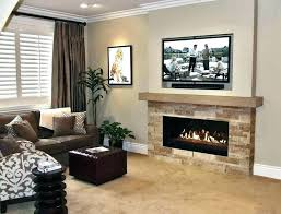 on fireplace mantel where to put cable box above hang mounting into stone cabinet television tv