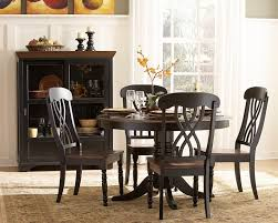 dining room round black wooden dining table with one leg combined with black wooden chairs