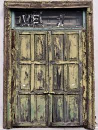a very old wooden door painted green with weathered paint coating stock photo colourbox