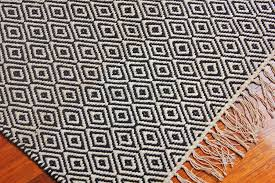 hand woven flatweave 3 x 6 black and white diamond pattern area rug