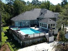 above ground pool rectangle this rectangular above ground pool it entirely surrounded by deck this makes above ground pool rectangle