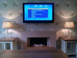 install tv above brick fireplace over hide wires mounting hiding cables