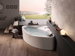 corner whirlpool bathtub the essentials 130x130 by jacuzzi