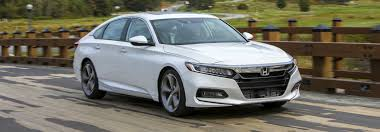 2018 honda white. 2018 honda accord sedan in white driving