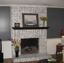 brick fireplace brick fireplace had been painted metallic orange by previous owner used 4 diffe paint colors to achieve the makeover