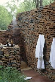 outdoor shower partition wall privacy stone wall garden ideas