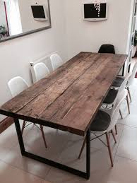 here is our 6 8 seater dining table made from reclaimed timber and steel the top is made from solid 21 2 thick timber the grain and look of the wood is