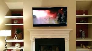 hanging tv over fireplace mounted mount too high ideas