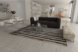 stripes beige and black and white patchwork cowhide rug in an open living room