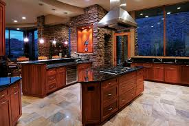 faux stone fireplace kitchen mediterranean with accent lighting art cultured fireplaces veneer