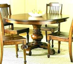 small round glass dining table uk solid wood end tables kitchen and chairs set wooden sealer