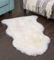 Sheep skin rug Round Whiteivory Shearling Sheepskin Rug Sheepskinshopcom White Ivory Sheepskin Rug Single Lambskin Shearling Pelt Large 35ft
