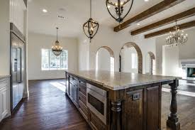 custom spanish style furniture. Wood Beams. Statement Dining Chandelier. Texas Spanish Kitchen. Bannister Custom Homes. Style Furniture I