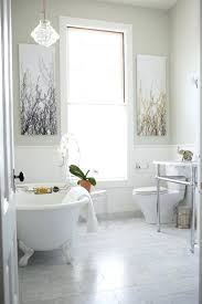 marble bathrooms subway tiles console sink claw foot tub two piece toilet hanging lamp standing carrera