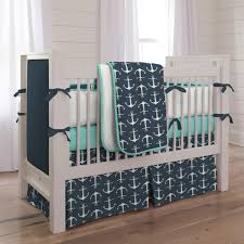 Can't go wrong with a classical nautical theme! Navy Anchors Crib Bedding  