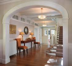 Stupefying Beautiful Foyers Ideas in Entry Traditional design ideas with arched  doorway artwork chandelier fluted woodwork gracious