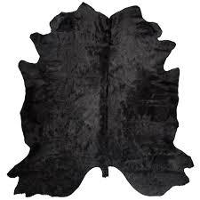 black cowhide rug for